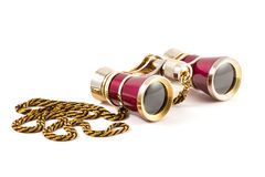 Red theater binoculars with golden cord on white background, isolated Stock Photography