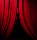 Red theater curtain. With soft lighting over black royalty free stock images