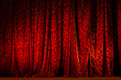 Red Theater Curtain illuminated. With spot light Royalty Free Stock Photos