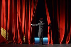 Red theater curtain. At the theater stock photography