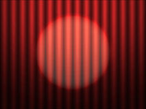 Red theater curtain with spotlight Royalty Free Stock Photography