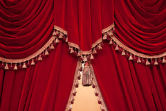 Red theater curtain with tassels Stock Photo