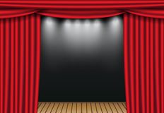 Red theater curtains with spotlight and wooden stage. Open velvet drapes Stock Photo