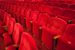 Red theater seats. French classical red velvet theater seat in rows Stock Photos