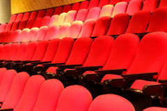 Red theater seats. Photograph of some empty red theater seats royalty free stock photo