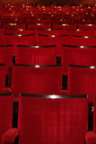 Red Theatre. Red Chairs in a theatre.  Perfect for inserting a person into the image to make them appear as though they were in the theatre.  Also useful for Royalty Free Stock Image