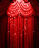 Red theatre curtain. With spotlight and stars Stock Images