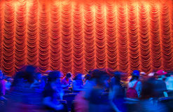 Red theatre curtain after the show end with crowd Stock Images