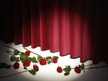 Red Theatre Curtain on stage with red roses stock photography