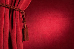Red theatre curtain. And red tassels Royalty Free Stock Photo
