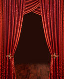Red theatre curtains. Red theatre stage curtains, brown wooden floor and dark background, vertical stock photo