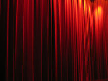 Red theatre curtains. Photo of plush red theater curtains Royalty Free Stock Images