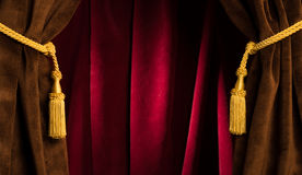 Red theatre curtains. And yellow tassels Royalty Free Stock Photos