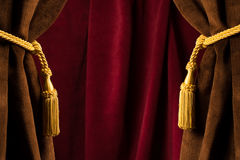 Red theatre curtains. And yellow tassels Stock Photo