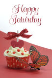 Red theme cupcake with butterfly on red and white background with Happy Saturday sample text Stock Photography