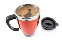 Red thermos with coffee drink and lid Stock Photo