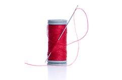 Red thread bobbin and needle Royalty Free Stock Image
