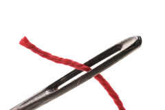 Red thread in the eye of the needle Royalty Free Stock Photography