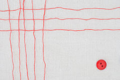 Red thread grid and button. On white fabric background Stock Photography