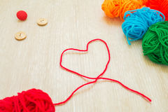 Red thread with heart shape Royalty Free Stock Photography