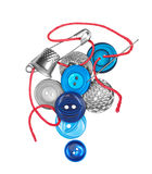 Red thread with needle sews the blue button Royalty Free Stock Images