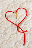 Red thread in the shape of a heart Royalty Free Stock Photos