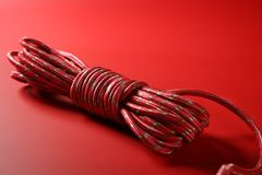 Red thread spool on monochrome background Royalty Free Stock Photo