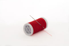 Red thread spools on the white background Royalty Free Stock Photos