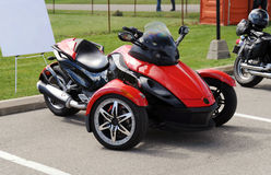 Red three wheel motorcycle. On the parking lot Royalty Free Stock Photo