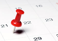 Red Thumb Tack. On Calendar Page stock images