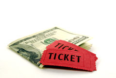 Red Tickets for Admission with Cash. Two torn red tickets for admission to an event on top of cash royalty free stock photo