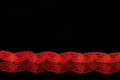 Red tickets on black Stock Photo