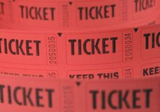 Red Tickets on a Roll. Red tickets on a large roll used for raffles and admission Royalty Free Stock Image