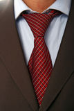 Red tie. Detail of a Business man Suit with red tie Royalty Free Stock Images