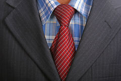 Red tie. Detail of a Business man Suit with red tie Stock Photo