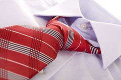 Red tie. Blue shirt and red tie on white Royalty Free Stock Images