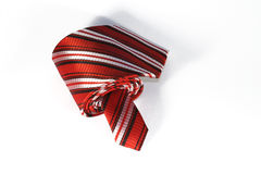 Red tie. Striped red and white tie on white background Royalty Free Stock Image