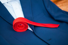 Red tie lies collapsed Stock Image
