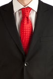 Red tie and suit detail Stock Image