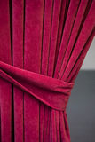 Red tied curtain Stock Image