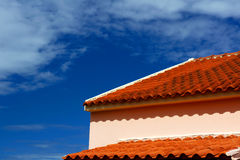 Red tile and blue sky Stock Photos