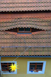 Red tile mansard roof Stock Photos
