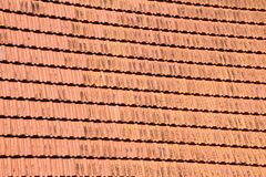 Red tile roof. Cose up on roof tilt shingle background royalty free stock photos