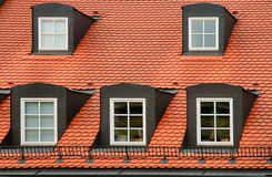 Red tile roof and gabled dormer windows on building in Munich, Germany. Typical red tile roof and gabled dormer windows on building in Munich, Germany Royalty Free Stock Photos