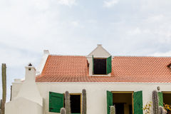 Red Tile Roof and Green Shutters on White Plaster Stock Images