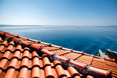 Red tile roof on the sea background Royalty Free Stock Images