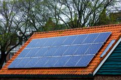 Solar panels house sky technology ecology alternative shaving economy old new roof tile cetamic encaustic. Red tile Roof with solar panels. New solar Stock Photos
