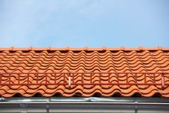 Red tile roof. With stairs royalty free stock images