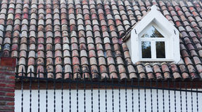Red tile roof with a window. Tarragona, Spain. Stock Images