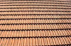 Red tile roofs. For the protection of buildings constructed with terracotta tiles and stuck together royalty free stock image